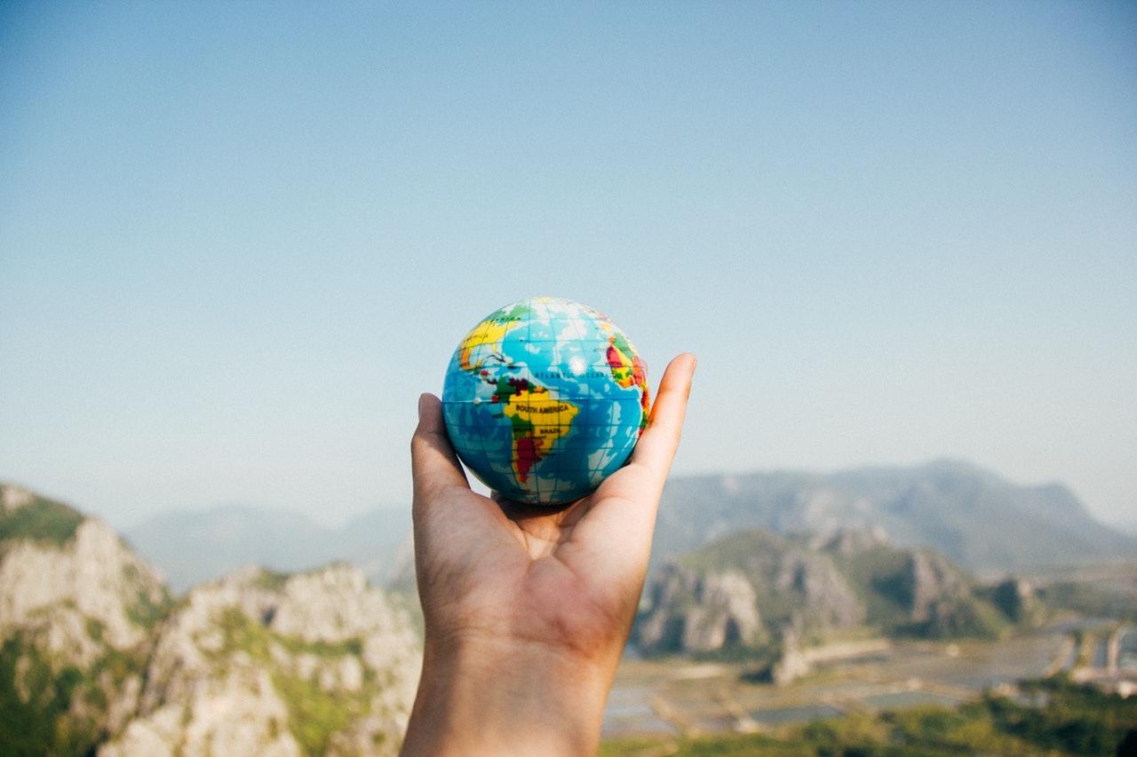 gap year globe in hand