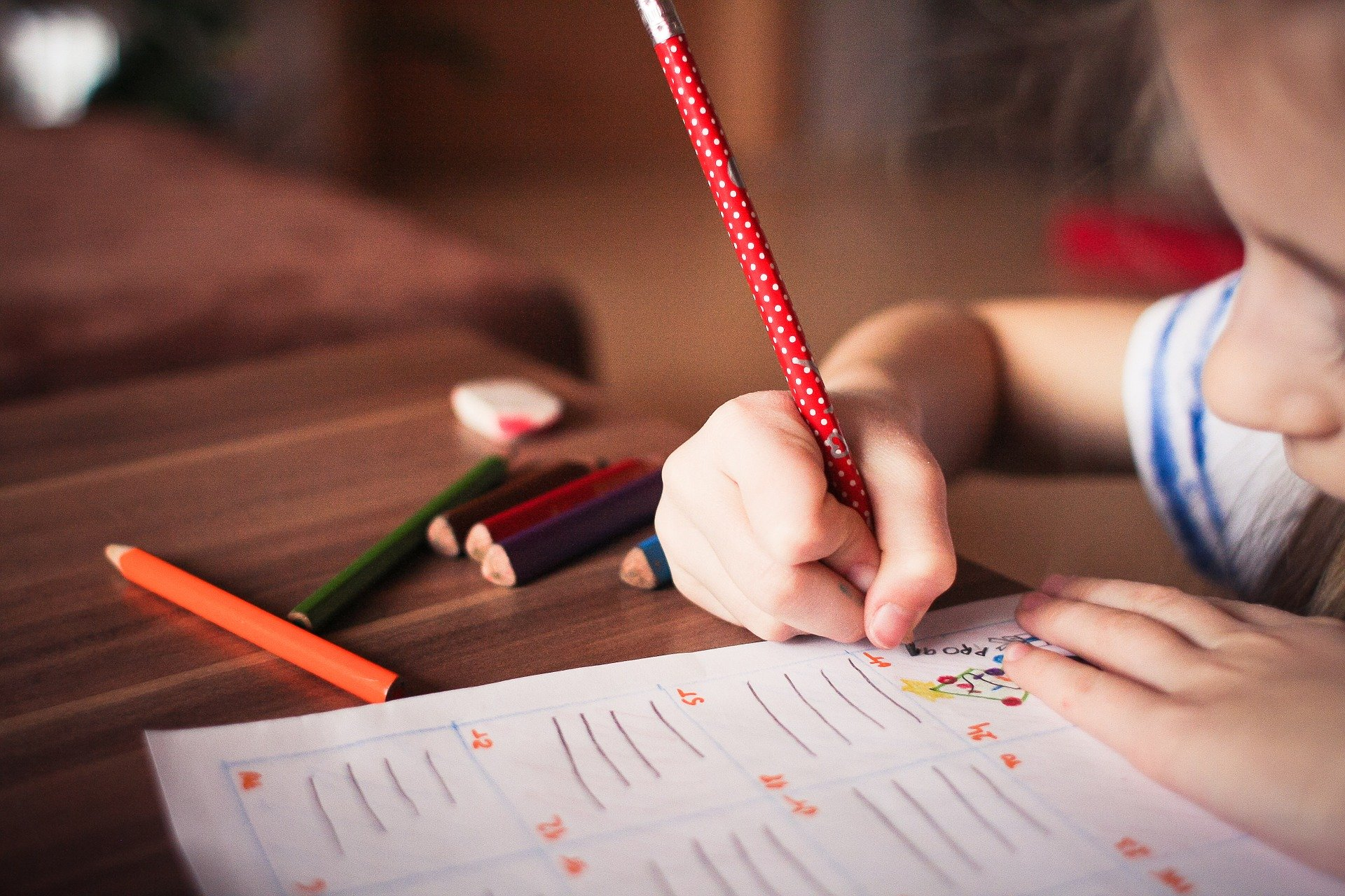home-schooling child writing